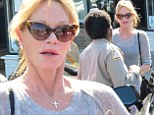 Giving her the slip! Melanie Griffith tries to sweet talk her way out of a parking ticket with no success while shopping in LA