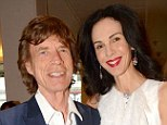 L'Wren Scott and Mick Jagger pictured together last year. The two were very 'lovey dovey' and were 'happy together', one friend said today
