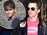 He is STILL wearing his wedding ring:  Olivier Martinez happily shows off his wedding ring in the face of marriage split rumours, as he flies out of Los Angeles alone