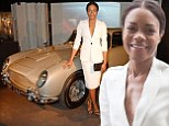 Worth every Moneypenny: Naomie Harris looks a million pound in a white skirt suit at the Bond In Motion exhibition