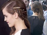 Getting to GRIPS with her side-sweep: Emma Watson uses quirky hair clips to slick her luscious locks to one side at Noah premiere