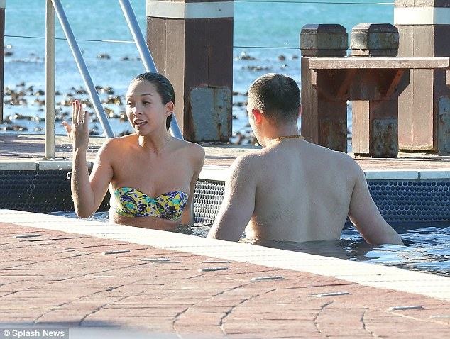 Mirror mirror? Myleene holds up her hand as the mystery man moves in closer
