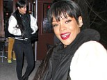 Rihanna keeps her new longer 'do in the same style as she shows off her street style in baseball jacket and designer backpack