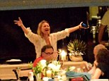 Having fun: Kate Moss sings and dances in an animated fashion on board Sir Philip Green's luxury yacht