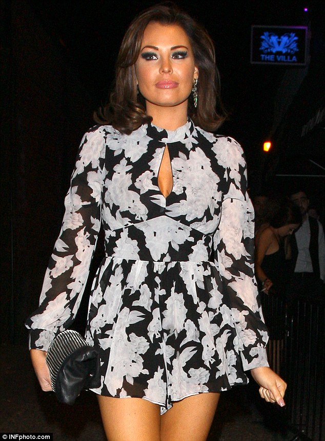 TOWIE WOWIE: Featuring a fun grey and black floral pattern, the sexy sheer garment had a cinched-in middle to complement the brunette's slim waist and a flimsy thigh-skimming hem