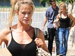 Wild Thing! Denise Richards goes make-up free with disheveled hair as she displays toned arms in a black sheer top