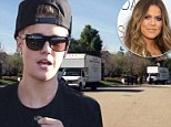Justin Bieber emerges from recording studio after making music all night... as moving vans clear his Calabasas mansion for new owner Khloe Kardashian