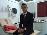 Protective: Jack Wilshere is still in a protective boot after breaking his foot while playing for England