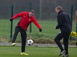 Working hard: Wayne Rooney tries to get the ball past manager David Moyes in training