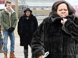 Baby its cold outside: Amber Riley drapes herself in a fur coast while filming a scene with Chord Overstreet  in the freezing New York weather