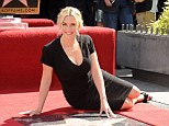Looking good: Kate Winslet showed off her pot-baby figure in a black shift dress as she accepted her star on Hollywood's Walk Of Fame on Monday