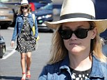 Not sure what to focus on: Reese Witherspoon teamed many eye-catching pieces together as she stepped out in Brentwood in Los Angeles on Monday