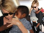 Charlize Theron is chic in blazer and leggings as she jets out of Los Angeles with son Jackson