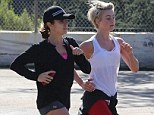 Perfectly in step! Julianne Hough and Nikki Reed are in absolute unison as they take their workout to the great outdoors