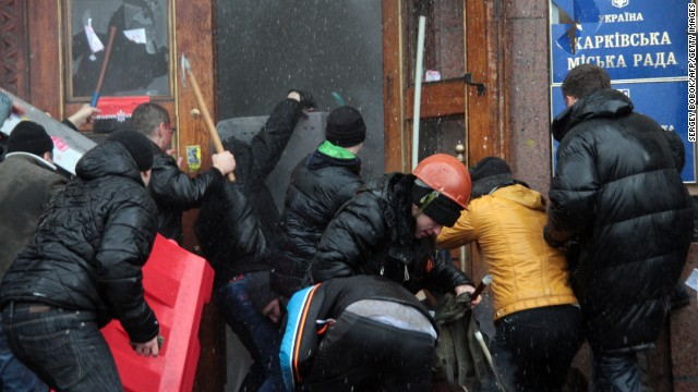 Pro-Russian activists clash with Maidan supporters as they storm the regional government building in Kharkiv, Ukraine, on March 1.