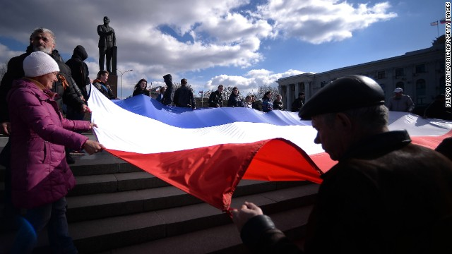 Demonstrators hold a Crimean flag at Lenin's Square in Simferopol on March 18.