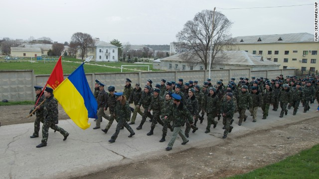 Ukrainian military members march at the Belbek air base on March 4.