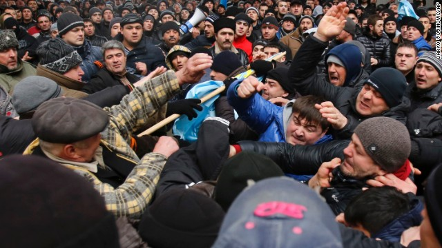 Pro-Russian demonstrators, right, clash with anti-Russian protesters in front of a government building in Simferopol on February 26.