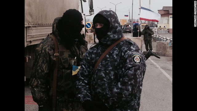 SOUTHERN UKRAINE: Gunmen block monitors from the Organization for Security and Co-operation in Europe (OSCE) who are trying unsuccessfully to negotiate their way into Crimea past pro-Russian border patrols on March 7. Photo by CNN's Christian Streib. Follow Christian on Instagram at instagram.com/christianstreibcnn