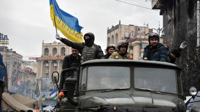 Anti-government protesters drive a military vehicle in Independence Square on February 22. Many protesters said they wouldn't leave the square until Yanukovych resigned.