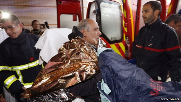 Ambulance workers treat man injured in rail accident near Digne-les-Bains, France (8 Feb)
