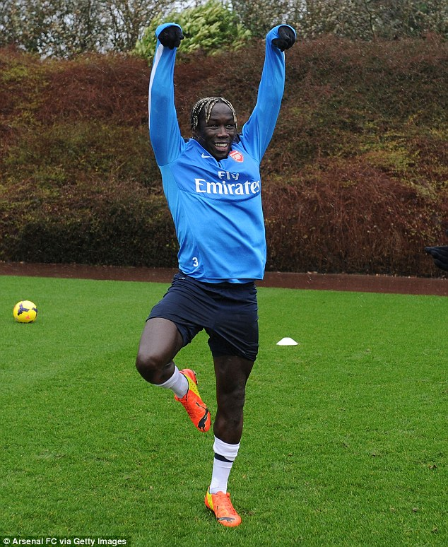 Balletic: Bacary Sagna shows off his dance moves as Arsenal trained at London Colney for the last time before their Premier League showdown with Manchester United on Wednesday night