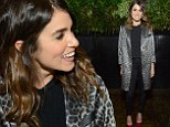 Nikki Reed covers up her toned figure in an oversized animal print blazer and a pair of  killer red heels