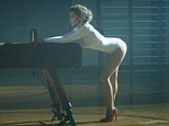 Workout: Kylie Minogue writhes and poses in the video for sexercise