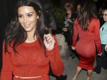Kim Kardashian shows off her curvaceous derriere in figure hugging skirt while baring a glimpse of midriff in cropped top