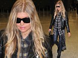 Serious work mode: Fergie opted for a leather jacket and leather-look trousers as she touched down in Washington on Wednesday