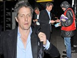 Giving generously: Hugh Grant was spotted giving a Big Issue vendor £5 for a magazine on Wednesday night