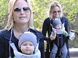 Malin Akerman is a mother on the go as she carries her son Sebastian and a hot caffeinated beverage while on a stroll