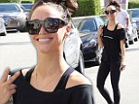 Have the endorphins even kicked in yet? Cara Santana beams as she heads to a workout session at the Tracy Anderson Gym
