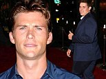 Scott Eastwood laps up the attention while Christopher Schwarzenegger flashes a shy smile at dad Arnie's Sabotage premiere