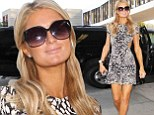 No wonder she needed sunglasses! Paris Hilton looks radioactive as she shows off blotchy fake tan in cut-out sundress