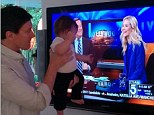 Precious: Jaime King instagrammed this image of her husband, Paul Newman, 38, and five-month-old son James watching her on KTLA on Wednesday