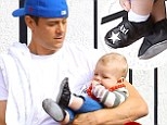 Daddy's little star! Josh Duhamel's mini-me Axl displays his cute monogrammed shoes as the pair bond over a father-son breakfast in LA