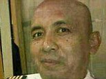 Investigators are now urgently trying to work out who Capt. Zaharie Ahmad Shah spoke to before the plane took off on March 8