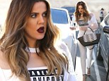 Making a statement: Khloe Kardashian wore a 'PARENTAL ADVISORY EXPLICIT CONTENT' shirt as she grabbed frozen yoghurt with her sister Kim on Thursday