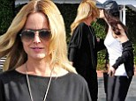 Back in black! Mena Suvari was dressed to impress for a lunch date with a girlfriend in West Hollywood on Thursday