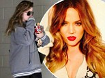 Khloe Kardashian keeps trim at the gym in baggy workout top... before showing her glamorous side in stunning Instagram snap