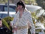 Hound dog: Ron Livingston sports sideburns and a white patterned suit and belt as he emerged onto the set of film Shangri-La Suite in Los Angeles on Wednesday