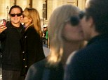 Sealed with a bisou: Heidi Klum, 40, kisses toy boy Vito Schnabel, 27, while playing tourists during romantic getaway in Paris