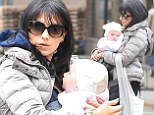 'Costume change!' Hilaria Baldwin slips into winter wear as she bonds with baby Carmen after posting sultry bedroom yoga snap