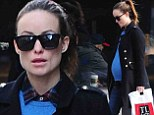 Bumpin' in blue! Pregnant Olivia Wilde looked uber-chic as she stepped out in New York's West Village on Thursday