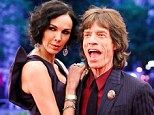 Mick Jagger reportedly left L'Wren Scott behind on the latest Rolling Stones world tour because his bandmates branded her the group's Yoko Ono