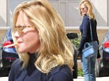 Not a good look! Melanie Griffith puffs away on a cigarette as she heads to luxury department store