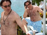 Soaking it all in: Andy Garcia relaxes poolside in Miami ahead of being honoured as the inaugural inductee into the city's Walk Of Fame