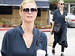 Make-up free Heidi Klum grabs Starbucks in Brentwood following romantic Parisian getaway with toyboy Vito Schnabel