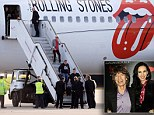 Stones arrive back in UK